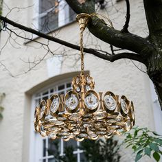 Gilded Brass and Crystal Chandelier by Palwa   From a unique collection of antique and modern chandeliers and pendants  at https://www.1stdibs.com/furniture/lighting/chandeliers-pendant-lights/