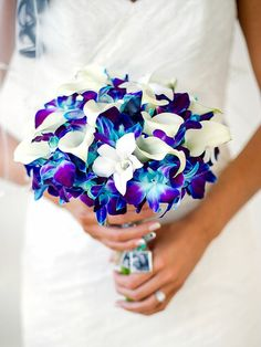 A beach chic wedding at the postcard inn beach resort and marina in islamorada, florida. bright blue and purple orchid bouquet Purple Orchid Bouquet, Blue And Purple Orchids, Blue Orchid Wedding, Orchid Bouquet Wedding, Calla Lily Bouquet, Blue Bouquet, White Wedding Bouquets, Calla Lilies, Wedding Lavender