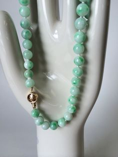 21 inches long  Jade beads graduating in size from 9mm to 7mm  60 beads  58.25g total weight of necklace 14k oriental clasp