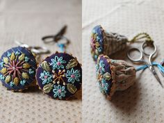 These would make super cute earrings! fab idea for embroidered flower accessory in ethnic,gypsy mexican folk style ,frida would have loved these,especially if they also had teardrop tassels dangling beneath the stud in aquamarine or gold