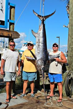 Fishermen at Zeke's Landing Marina in Orange Beach pose with this giant swordfish.