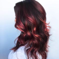 "Long layers and ""black cherry"" Aveda hair color make this look by Aveda Artist team Susan Ford, Raul Delgado, and Shannon O'Reilly at Asha Salon Spa extra eye-catching for fall."