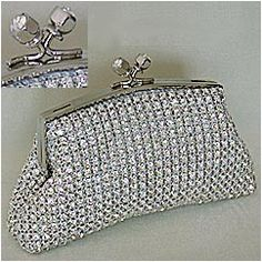 Tiny Swarovski Crystal minaudieres.  Perfect little satchels for brides and evening wear that can be worn over the shoulder or held in the palm of your hand. Just large enough for your necessities.
