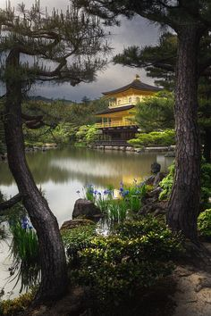 The Golden Pavillion of the famous Kinkaku-ji temple in Kyoto, Japan. I was hoping for a nice sunst, but the the clouds never lightened up. The place was very crowded, but very much worth a vistit!    More Pictures from Japan on my facebook page: www.facebook.com/PatrickHuebscher