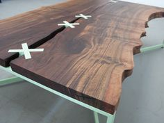 Butterflies in Wood joints / The Stitch Table by Uhuru Design of Brooklyn, a modern spin on the traditional butterfly shape.