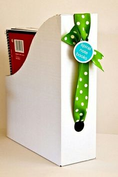 Organize magazines, folders, books in magazine storage bins that are decorated w/ribbons & tags.