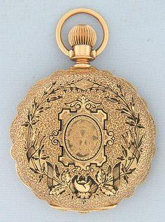 Fine Elgin 14K gold and enamel scalloped case midsize antique pocket watch circa 1885.