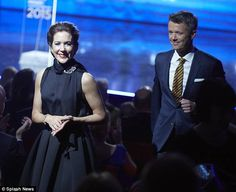 Enamoured: The heir to the Danish throne looked happy to follow his wife's lead as she held court in the audience