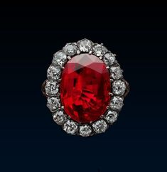 """Queen Marie José Royal Ruby Ring, c. 1870, gold, silver, diamonds, ruby (8.48ct). When Belgian Princess Marie-José married the Prince of Piedmont, future Umberto II in 1930, she received jewellery inherited from his grandmother, Queen Margherita. He chose the ring for Princess, married to the heir to the throne of Italy, for the royal character of the """"pigeon-blood"""" ruby from Burma within its diamond frame blended harmoniously with Queen Margherita's bequests."""