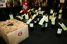 """""""Wine Pull"""" idea for an auction.  Either number the bottles or completely wrap them and pull a cork with a number on it to wine a bottle. The price for the pull should be equal to the value of the bottle.  $25 or for better wines even more."""