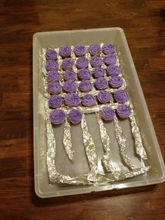 Cupcake carrier - place them in plastic storage box, use tinfoil to keep them separate