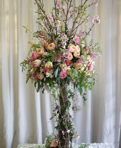 romantic garden tall centerpiece with branches roses vines