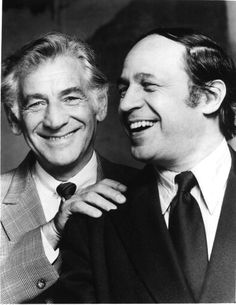 Composers Leonard Bernstein and Pierre Boulez share a laugh.