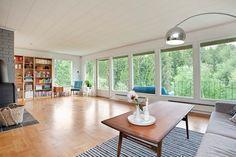 Great windows, light and view in this livingroom! FINN Eiendom - Bolig til salgs