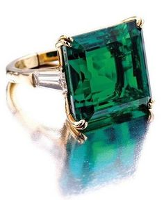 Vintage emerald ring ~ this looks very much like my emerald ring with baguettes