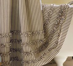 10 Ways to Add Farmhouse Style - Live Creatively Inspired....Pottery Barn ticking shower curtain with ruffles....love