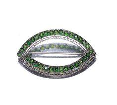 Platinum and Demantoid Garnet Brooch   Platinum, the stylized navette-shaped openwork brooch embellished by 32 round demantoid garnets, signed Tiffany & Co., circa 1910