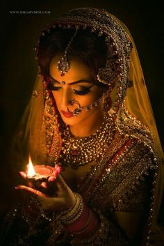 Indian bride with a dia in hand Bridal photoshoot ideas. Bridal Poses, Bridal Photoshoot, Bridal Shoot, Wedding Poses, Bridal Portraits, Photoshoot Ideas, Indian Wedding Photography, Wedding Photography Poses, Jewelry Photography