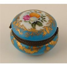 Limoges box - Blue and gold with flowers.  The Limoges Box is produced by Limoges factories near the city of Limoges, France that are collected worldwide made of a specialized porcelain made of a clay called Kaolin that is only found in the Limousin Region of France.