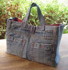 Large Tote or Bag made with recycled denim. Mine is lined with green lady bug fabric. I did this pre- pintrest. I use it every time I fly.Large Tote or Bag made with recycled denim. Use fun fabric for the lining! Great for a pair of jeans with awesom Jean Purses, Purses And Bags, Diy Sac, Denim Purse, Denim Ideas, Denim Crafts, Upcycled Crafts, Old Jeans, Jeans Pants