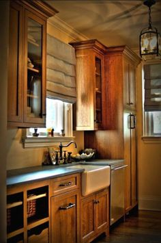 Mission Style Kitchen Cabinets. Glass wall cabinets, farm sink, open shelves.