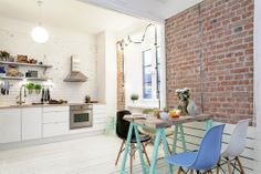Exposed brick & white with pastel accents. Such a clean and lovely look. The Design Chaser