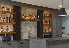 A sophisticated finished basement with a wet bar is the perfect place to huddle with friends and family to cheer on your favorite team. Finished Basement Bars, Wet Bar Basement, Basement Bar Designs, Home Bar Designs, Basement House, Basement Kitchen, Wet Bar Designs, Basement Ideas, Basement Decorating Ideas