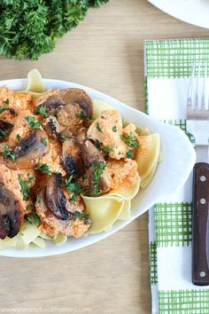 Healthy and creamy chicken stroganoff (made using yogurt, surprise!) and served over egg noodles.