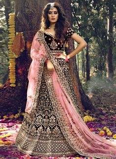 You look so charming wearing this attire. Outstanding craftmanship of embellishments exhibited in this maroon velvet trendy lehenga choli. You will be able to see some intriguing patterns performed with dori work and stone work. Comes with matching choli and dupatta. (Slight variation in color, fabric & work is possible. Model images are only representative.) Indian Wedding Lehenga, Indian Lehenga, Bridal Lehenga Choli, Saree Wedding, Wedding Wear, Indian Bridal, Net Lehenga, Bridal Lehenga Online, Lehenga Choli Online