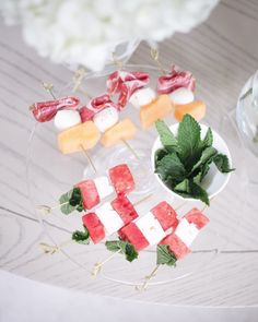 Choose a seasonal menu, like watermelon and feta salad for spring or summer. Skewers are great for presentation and for easy munching!