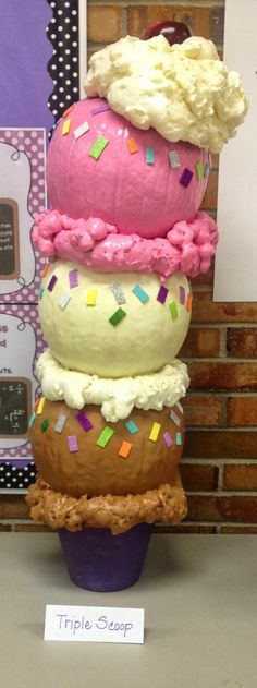 "Ice Cream Cone made with pumpkins. ""whipped cream"" and the rings between the pumpkins? used spray foam insulation in the can…only about $3 at WalMart!! K is for Kinderrific!"
