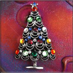Vintage Christmas Tree Pin/Brooch with many colored Rhinestones... pinning this because my mother-in-love would wear one like it every Christmas. Miss seeing it...miss her! ~ ALW