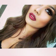 Dramatic eyes, full lashes, and deep red lips | thebeautyspotqld.com.au