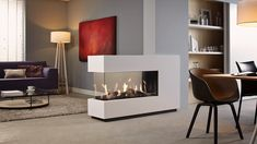 With this U-shaped gas fire you can divide your living space and still enjoy the luxury of a warm, realistic log fire from wherever you sit. Modern Fireplace Decor, Modern Electric Fireplace, Contemporary Fireplace Designs, Home Fireplace, Living Room With Fireplace, Living Room Decor, Modern Fireplaces, Gas Fireplaces, Living Room Designs