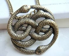 The Never Ending Story -- Steampunk Vintage style two snake necklace --- Snake Xenzia. $6.00, via Etsy.