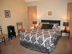 Staged master bedroom...air mattress for the bed and a painted black shutter for the headboard.  I have one accent wall painted behind the bed that matches the adjacent master bath.
