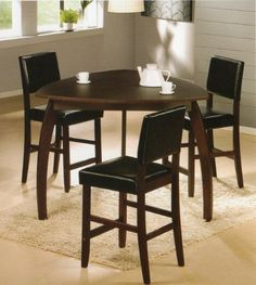 """4PC Triangle Solid Wood Bar Table and Stools Set by FurnitureMaxx. $449.99. Some assembly needed, instruction & hardwares in the box.. Table Dimension: 47.5"""" x 47.5"""" x 36""""H; 24"""" Seat Height Bar Chair 18"""" x 20"""" x 40.5""""H;. Table with 3 stools;. This counter height table uses subtle curves and a rich contemporary design to create a comfortable furniture collection that is sure to enhance the atmosphere of any dining experience. The rich espresso finish, flowing smoothly over the ..."""