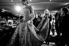 Pin for Later: If You Thought Catwalk Couture Looked Amazing, Wait Until You Go Backstage  Another heavy Elie Saab gown requires a whole staff to look after it!