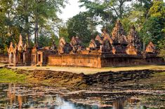 The red sandstone structures of Banteay Srei temple, also known as the Citadel of Women, near Angkor Wat in Cambodia