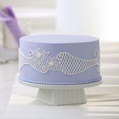 You'll look like a pro with this lace-like lattice cake design! (via wilton.com)