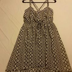 Super cute black & white Aztec dress Black & White with Aztec design, polyester, criss-cross spaghetti straps, built in slip, never been worn, still has tags BeBop Dresses Mini