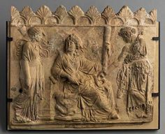Demeter seated in the centre; Kore and Triptolemus at Her side - from Campania, circa 1st c. BC - at the Louvre Museum