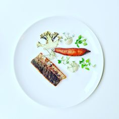 Fillet of river trout, cauliflower cream, sweet potato and burned cauliflower.