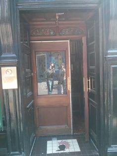 Door extender, way to extend the available doorway for large loads or create a classy breezeway/pet door. Seen in Edinburgh on Rose street.