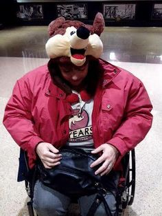 This Coyotes fans is showing off her loyalty with a unique Coyotes head-topper?!