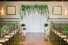garden wedding ceremony backdrop - photo by Meigan Canfield Photography http://ruffledblog.com/italian-wedding-inspiration-with-pops-of-red