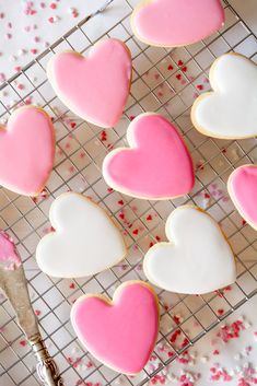 Looking for Valentine's Day cookie recipe ideas? These Heart-Shaped Sugar Cookies with white and pink pastel royal icing are so simple and delicious, even your littlest helpers can get in on the action. Click here for the recipe.