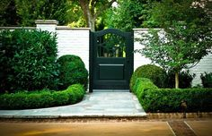 black wooden gate in white painted brick wall via LUCY WILLIAMS INTERIOR DESIGN BLOG: OUTDOOR INSPIRATION