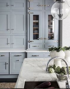 Kitchen Decor: 7 DIY Tips for a Sanctuary Feel Light blue kitchen cabinets, white marble countertop, and dramatic cabinet hardware.Light blue kitchen cabinets, white marble countertop, and dramatic cabinet hardware. Home Interior, Interior Design Kitchen, Home Design, Interior Ideas, Classic Kitchen, New Kitchen, Timeless Kitchen, Long Kitchen, 1950s Kitchen