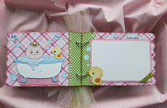 mini album with spaces left for pics, new mom can quickly put in pics and have a beautiful scrapbook